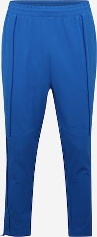 Pantaloni sport 'First Mile' de la PUMA pe albastru