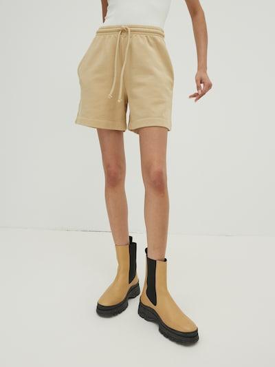 Pantaloni 'Daisy' EDITED di colore beige, Visualizzazione modelli