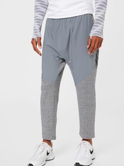 Sportinės kelnės iš NIKE, spalva – pilka / margai pilka, Modelio vaizdas