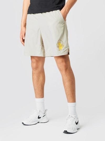 NIKE Sportovní kalhoty - béžová / žlutá / černá, Model/ka