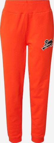 BOSS Püksid 'C_Ejoy_Russell Athletics', värv oranž
