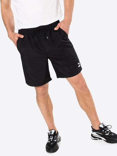 PUMA Kalhoty - černá / bílá, Model/ka