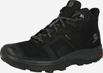 SALOMON Boots i svart
