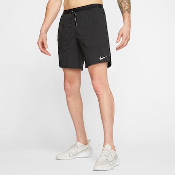NIKE Спортен панталон 'Flex Stride' в черно