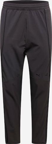 Pantaloni sport de la PUMA pe negru