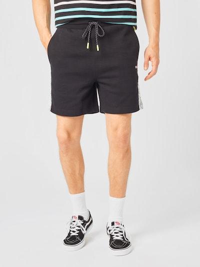 Tommy Jeans Spodnie w kolorze czarny / białym, Podgląd na modelu(-ce)