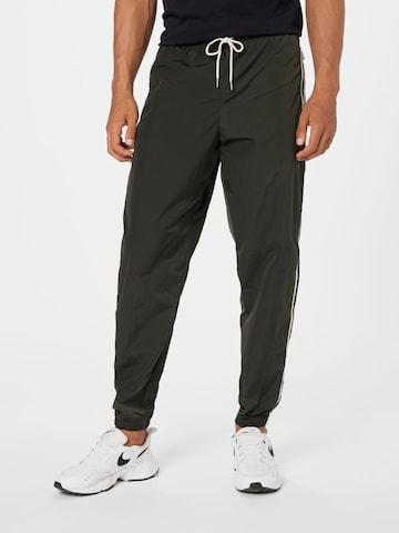 Pantaloni di Nike Sportswear in verde