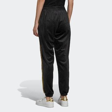 ADIDAS ORIGINALS ' Velvet Embossed adidas Originals Monogram and Gold Stripes Trainingshose ' in Schwarz
