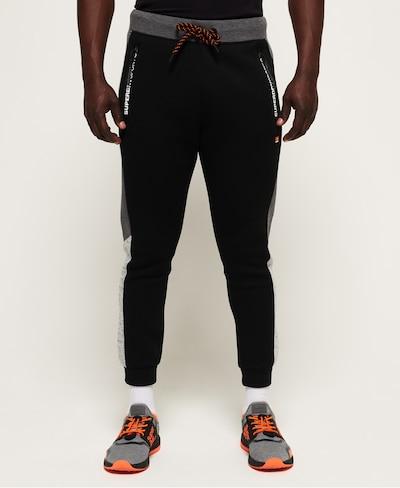 Superdry Sportbroek in de kleur Greige / Zwart: Vooraanzicht
