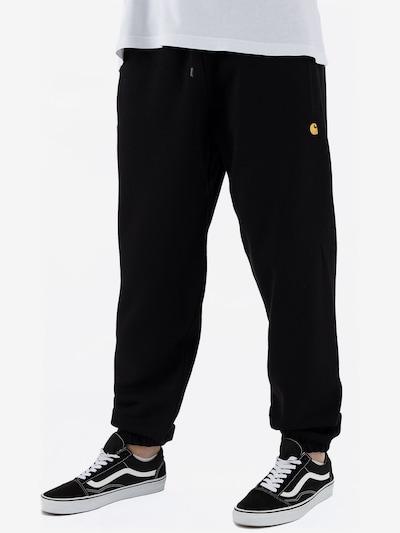 Carhartt WIP Jogginghose ' Chase ' in schwarz, Modelansicht