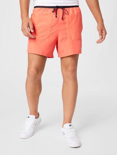NIKE Športové nohavice - sivá / koralová, Model/-ka