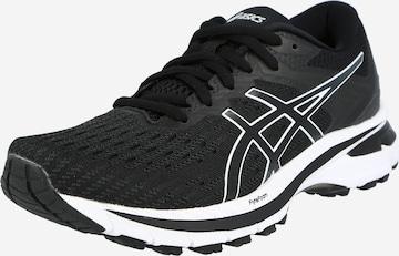Chaussure de course ASICS en noir