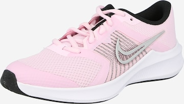 NIKE Sportschuh 'Downshifter' in Pink