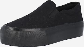 ABOUT YOU Slip on -tennarit 'Feline' värissä musta