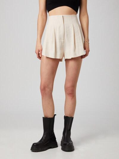ABOUT YOU x MOGLI Pantalon à pince 'Stella' en crème, Vue avec modèle