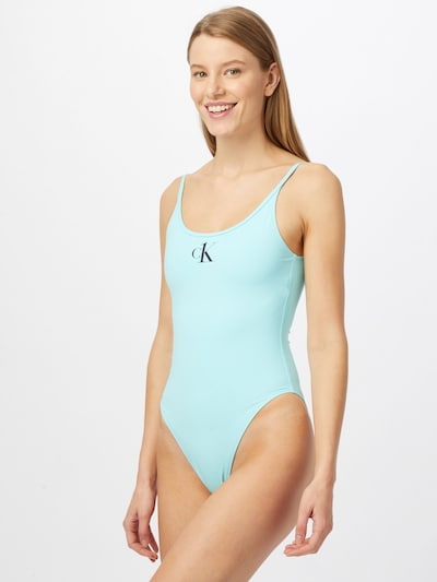 Calvin Klein Swimwear Swimsuit in Turquoise / Black, View model