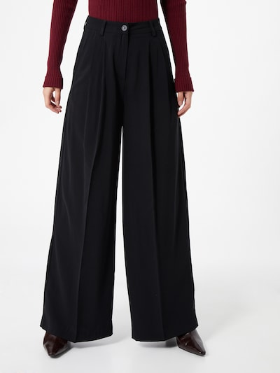 NU-IN Pantalon à plis en noir, Vue avec modèle