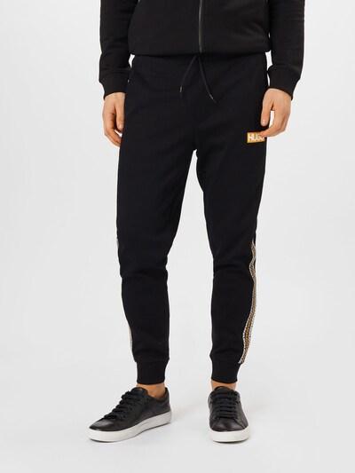 HUGO Spodnie 'Donburi' w kolorze żółty / złoty żółty / czarnym, Podgląd na modelu(-ce)