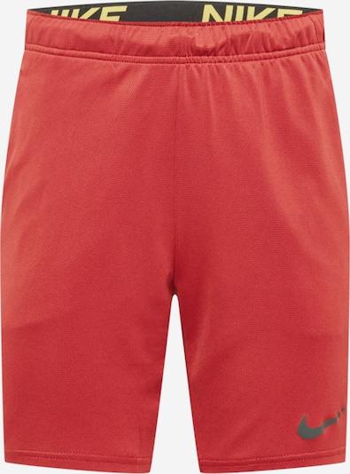 NIKE Pantalon de sport en jaune / melon / noir, Vue avec produit