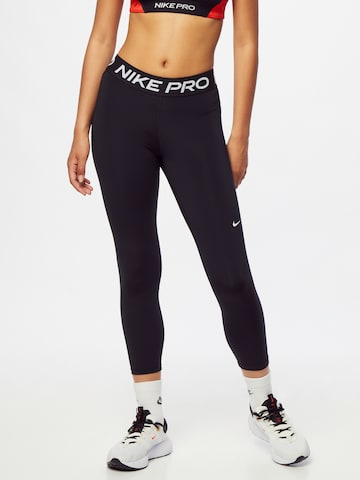 NIKE Sportnadrágok - fekete