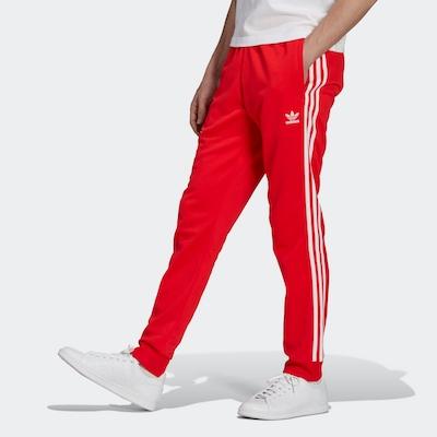 ADIDAS ORIGINALS Pantalon en rouge / blanc, Vue avec modèle