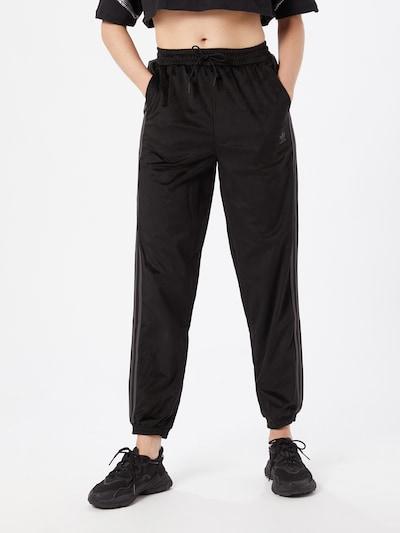 ADIDAS ORIGINALS Spodnie w kolorze czarnym, Podgląd na modelu(-ce)