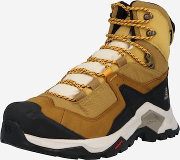 SALOMON Boots i beige
