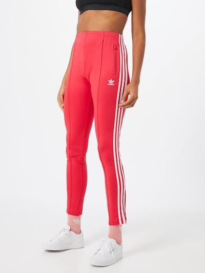 ADIDAS ORIGINALS Pantalon en rose foncé / blanc, Vue avec modèle