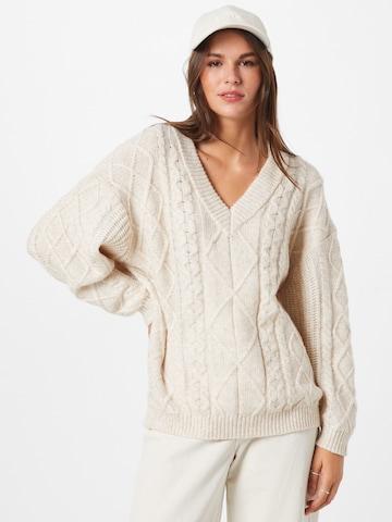 smėlio ABOUT YOU Megztinis 'Juna'