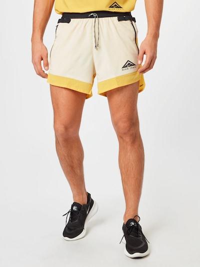 NIKE Športové nohavice - béžová / žltá / čierna, Model/-ka