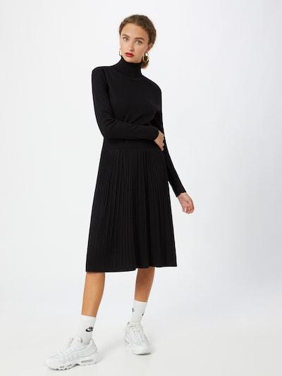 Calvin Klein Robes en maille 'Flare' en noir, Vue avec modèle
