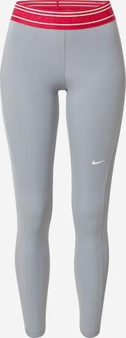 Pantaloni sport de la NIKE pe gri