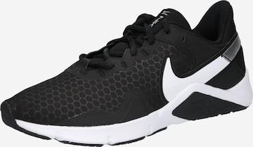 NIKE Urheilukengät 'Nike Legend Essential 2' värissä musta