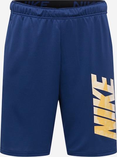 NIKE Pantalon de sport en bleu foncé / jaune / orange clair, Vue avec produit