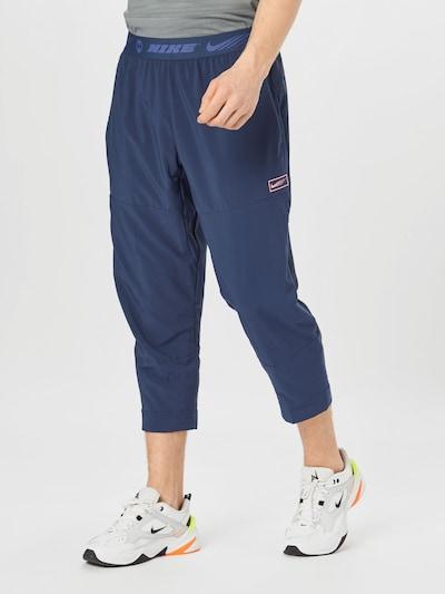 NIKE Pantalon de sport en bleu marine / bleu roi, Vue avec modèle