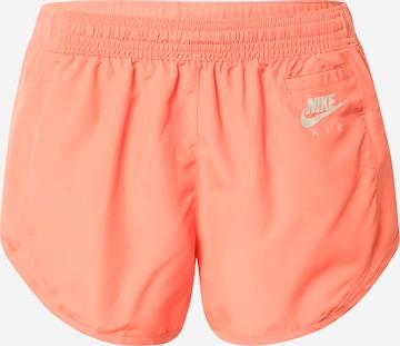 NIKE Workout Pants in Orange