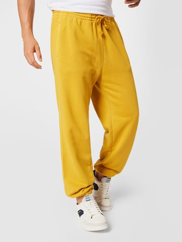 LEVI'S Trousers in Yellow