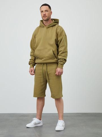 DAN FOX APPAREL Püksid 'Tino', värv roheline