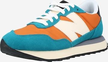 Baskets basses new balance en orange