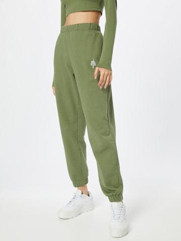 ABOUT YOU x INNA Püksid 'Sandra', värv roheline