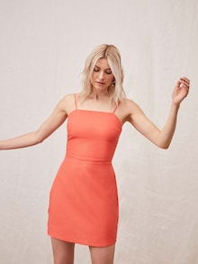 Lena Gercke in een oranje mini-jurk van LeGer