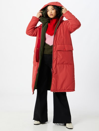 Woman in a long red parka by OOF