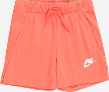 Pantaloni de la Nike Sportswear pe portocaliu