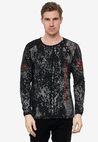 Rusty Neal Cooles Langarmshirt mit angesagtem Allover-Print in schwarz: Frontalansicht