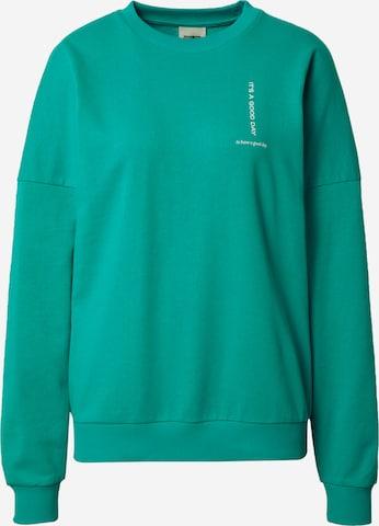 ABOUT YOU x Laura Giurcanu Sweatshirt 'Luca' i grønn