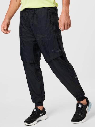 Sportinės kelnės iš NIKE, spalva – juoda, Modelio vaizdas
