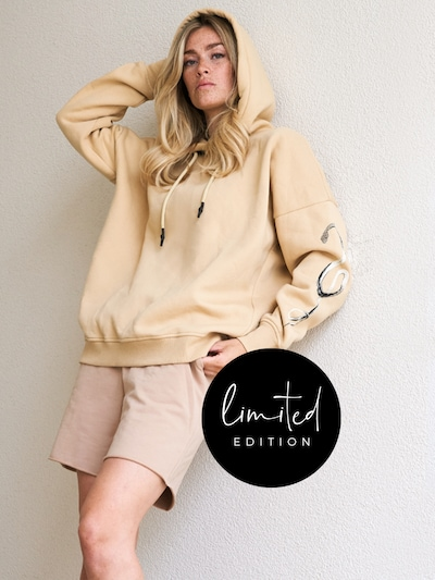 ABOUT YOU Limited Sweatshirt 'Kiki' in Beige: Frontal view