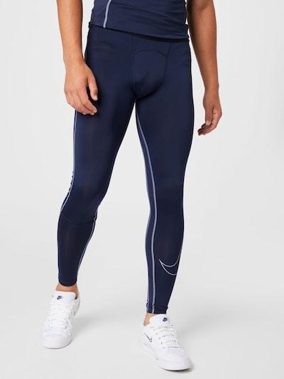 Sportinės kelnės iš NIKE, spalva – tamsiai mėlyna / pastelinė violetinė / juoda, Modelio vaizdas