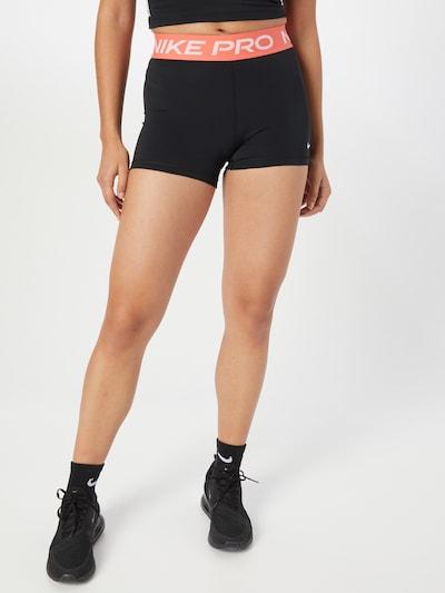 NIKE Sportovní kalhoty - korálová / černá / bílá, Model/ka