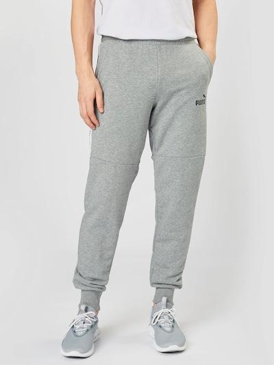 PUMA Spodnie 'AMPLIFIED' w kolorze nakrapiany szary / czarny / białym, Podgląd na modelu(-ce)